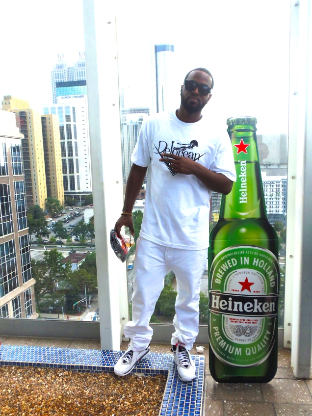 H Town's Mr. DeLorean was out and about in the city of Atlanta during A3C. Definitely putting on for his brand and the city. Get into what he rocked at the Poolside Mixer! T-shirt: HIS OWN BRAND! DeLorean Tees! Jeans: 501 Levi's White Jeans. Kicks: Jordan's Retro 8: Bugs Bunny Edition. Thank you DeLo! (I'll be hitting you up for a shirt) HA!