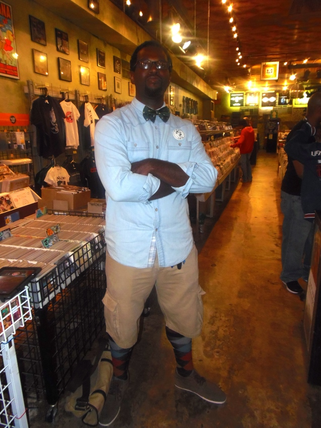 The minute I arrived in Criminal Records in Little 5 Points, Mr. Real Talk Raps caught ALL of my attention. His fit just flowed so well. Let's get to it! Button Down Shirt: Forever 21 for Men. Shorts: Cargo's from Footlocker. Bowtie: American Armadillo. Socks: Men's Warehouse. Shoes: Call It Spring. Button on the lef side of his chest, his own! Thank you so much Real Talk! Looking forward to upcoming projects and keeping up with your style!